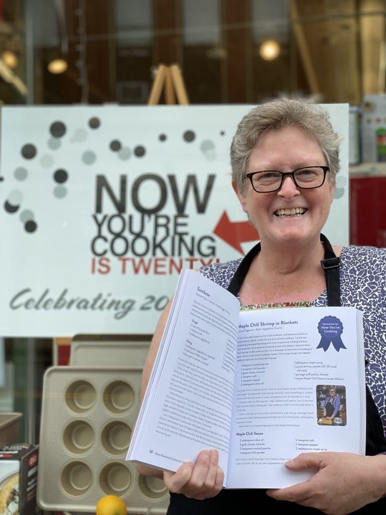 Louisa with Maine Bicentennial Cookbook