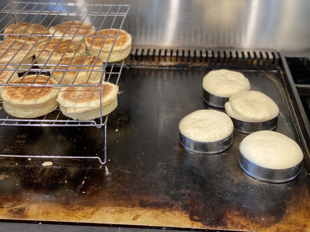 English muffins on griddle