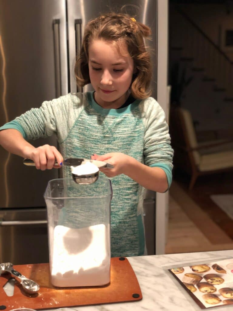 Avery measuring flour for muffins