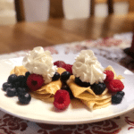 Crepes on a plate with whipped cream