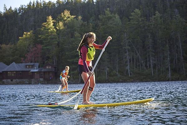 Two girls paddleboarding