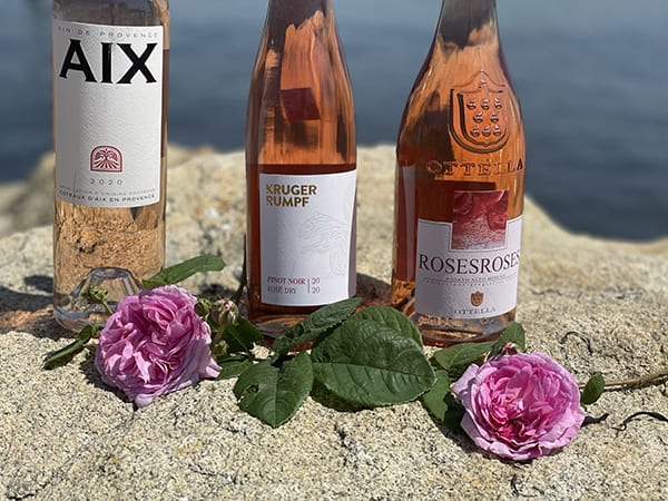 3 bottles of rose by water
